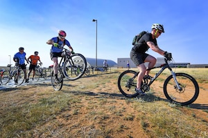Bicyclists race during an annual athletic event.