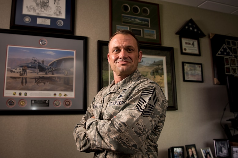U.S. Air Force Chief Master Sgt. Shane Wagner recently, 633rd Air Base Wing command chief, poses for a photo in his office at Joint Base Langley-Eustis, Virginia, Aug. 3, 2018.