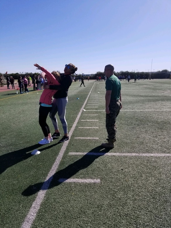 High school educator Briana Allen performs the combat fitness test aboard Marine Corps Recruit Depot San Diego during the Educators Workshop this past February. The workshop is a week-long program designed to better inform high school teachers, coaches and administrators about the benefits and opportunities available in the Marine Corps. (Photo by Sgt. Michelle Reif)