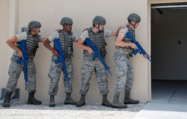 U.S. Air Force 6th Security Forces Squadron augmentees participate in a room clearing exercise at MacDill Air Force Base, Fla., July 25, 2018.