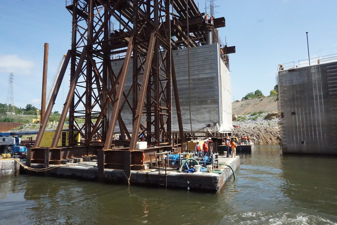 The U.S. Army Corps of Engineers Nashville District and its contractor partner Johnson Brothers put a 1.3 million pound concrete shell into position Aug. 6, 2018 on the riverbed on downstream end of Kentucky Lock where it will be part of a coffer dam and eventually a permanent part of the new lock wall for the Kentucky Lock Addition Project. It is the first of 10 shells that will be placed over the next year. The lock is located at Kentucky Dam, which is a Tennessee Valley Authority project at Tennessee River mile 22.4. (USACE Photo by Mark Rankin)