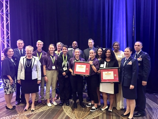 Members of Team MacDill pause for a photo while receiving the Pete Taylor community partnership award.