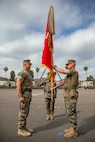 U.S. Sailors Capt. Jonathan P. Wilcox (left), the on-coming battalion commander for 1st Medical Battalion, 1st Marine Logistics Group, and Capt. Spencer T. Schoen (right), the off-going commanding officer of 1st Medical Battalion, prepare to exchange the unit colors during a change of command ceremony at Camp Pendleton, Calif., July 18, 2018. Wilcox relinquished his command after two years with 1st Medical Battalion to Schoen. The battalion provides health service support to the Marines and Sailors of the 1st MLG to ensure unit readiness. (U.S. Marine Corps photo by Cpl. Salmineo Sherman Jr.)