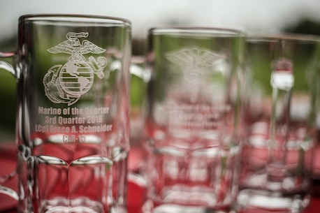 U.S. Marines and Sailors with 1st Marine Logistics Group receive cups of recognition for their outstanding accomplishments during an award ceremony at Camp Pendleton, Calif., July 26, 2018. During the awards ceremony, Marines and Sailors received different awards for their hard work and dedication. (U.S. Marine Corps photo by Pfc. Timothy Shoemaker)