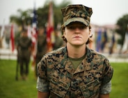 U.S. Marine Lance Cpl. Grace Schneider, a motor transportation operator with 1st Maintenance Battalion, Combat Logistics Regiment 15, 1st Marine Logistics Group, receives the Marine of the Quarter Award during an awards ceremony at Camp Pendleton, Calif., July 26, 2018. She received the award for her outstanding work performance and dedication while performing her duties as a motor transportation operator. (U.S. Marine Corps photo by Pfc. Timothy Shoemaker)