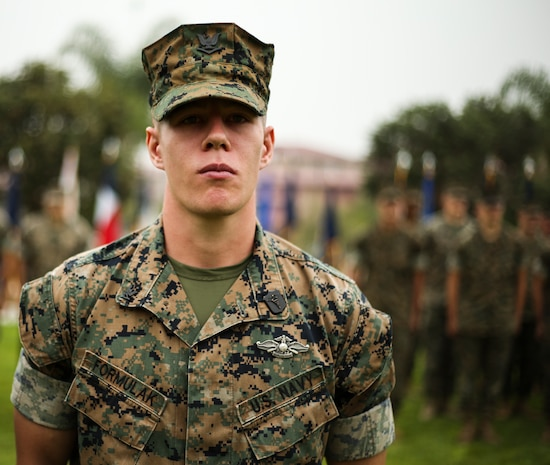 U.S. Navy Petty Officer 3rd Class Jared Formulak, a field medical technician with 1st Medical Battalion, 1st Marine Logistics Group, receives the Blue Jacket of the Quarter Award during an awards ceremony at Camp Pendleton, Calif., July 26, 2018. He received the Blue Jacket Award for his enthusiasm, professionalism, and unwavering devotion to duty. (U.S. Marine Corps photo by Pfc. Timothy Shoemaker)