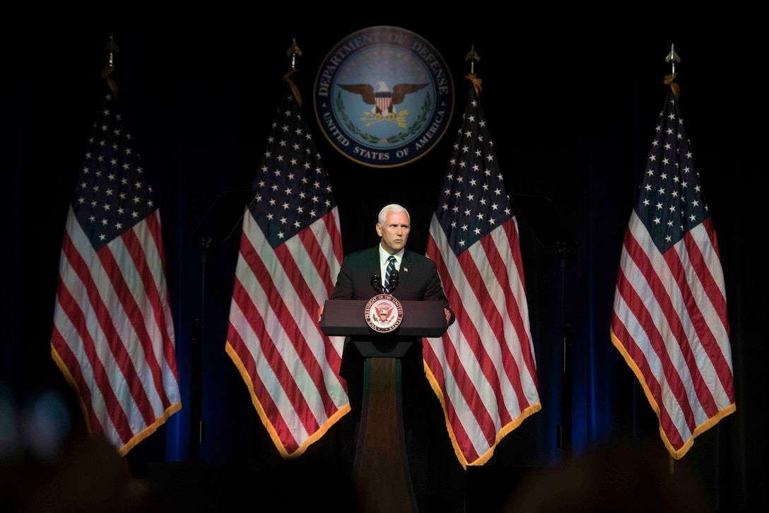 Vice President Mike Pence gives a speech behind a podium.