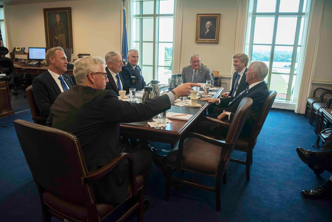 Vice President Mike Pence speaks to Defense Secretary James N. Mattis and other people during a meeting at the Pentagon.