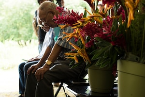 Gregorio Calvo, Yigo native, observes a moment of silence during the Chaguian Massacre Memorial in Yigo, Guam. Calvo, born March 9, 1947, has four relatives who were lost in the 1944 massacre: Jose Cruz Borja, Alberto Salas Cruz, Juan Salas Leon Guerrero, and Juan Blas Salas. (U.S. Air Force photo by Tech. Sgt. Jake M. Barreiro)