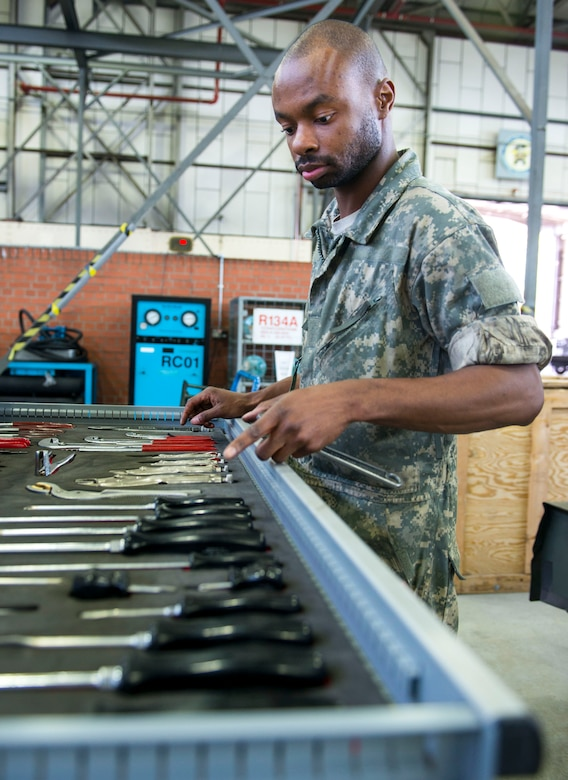 U.S. Air Force Senior Airman Lamar Cotton, 100th Maintenance Squadron aerospace ground equipment journeyman, looks for his next tool while working on a diesel generator at RAF Mildenhall, England, May 8, 2018. Aerospace ground equipment Airmen maintain a variety of essential equipment such as generators, heaters and flood lights, which are essential for crew chiefs and other flightline Airmen to do their jobs and keep the mission going. (U.S. Air Force photo by Airman 1st Class Alexandria Lee)