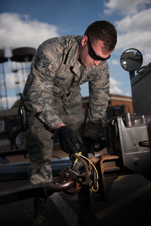 U.S. Air Force Senior Airman Michael McWhirt, 100th Maintenance Squadron aerospace ground equipment journeyman, attaches a diesel generator to a truck to bring to out to the flightline to power a KC-135 Stratotanker at RAF Mildenhall, England, May 8, 2018. A series of inspections must be completed before any aircraft can use the generator, which are an instrumental part in powering the KC-135 Stratotankers on the ground. (U.S. Air Force photo by Airman 1st Class Alexandria Lee)