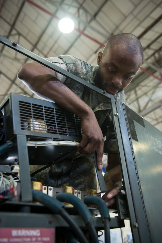 "U.S. Air Force Senior Airman Lamar Cotton, 100th Maintenance Squadron aerospace ground equipment journeyman, fixes a diesel generator's damaged power plane by replacing a damaged harness at RAF Mildenhall, England, May 8, 2018. AGE technicians use ground power to ensure the Bloody Hundredth's KC-135 Stratotankers are ready to provide the critical air refueling ""bridge"" that allows the ARW to deploy and project airpower around the globe at a moment's notice. (U.S. Air Force photo by Airman 1st Class Alexandria Lee)"