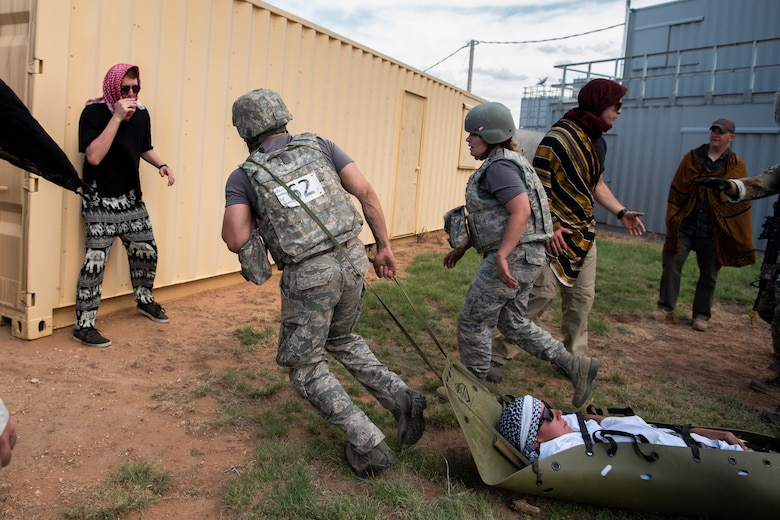 A medical technician from RAF Lakenheath, England, pulls a simulated wounded victim behind him during the Emergency Medical Technician Rodeo at Melrose Air Force Range, N.M., August 8, 2018. A total of 21 Air Force bases from around the world visited MAFR and Cannon Air Force Base, New Mexico, to participate in the EMT Rodeo, giving the technicians a wide assortment of scenarios to test their knowledge and training in the medical field. (U.S. Air Force photo by Airman 1st Class Gage Adison Daniel)