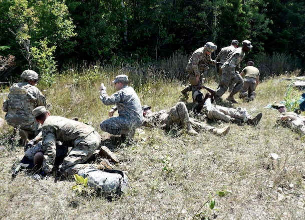 Medics from the 134th Medical Company, Camp Dodge, Iowa, and 2-135th General Support Aviation Battalion, Aroura, Co., pull simulated Marine casualties from an exercise crash environment at the Carmeuse Calcite Quarry, Rogers City, Mich., Aug. 9, 2018. The training helped medics with treatment, movement, and cover of casualties while under fire in a joint training environment.