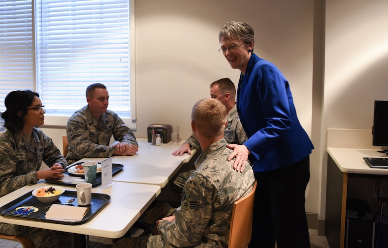 Secretary of the Air Force Heather Wilson greets Airmen during breakfast Aug. 8, 2018, at F.E. Warren Air Force Base, Wyo. Airmen of all ranks from various units across the base gathered for breakfast to provide Wilson with an overall perspective of their concerns and anticipations for the Air Force. Wilson visited F.E. Warren Air Force Base to emphasize the importance of the 90th Missile Wing's deterrence mission and to thank the Airmen for ensuring the mission is accomplished safely, securely and effectively every day. (U.S. Air Force photo by Airman 1st Class Abbigayle Wagner)