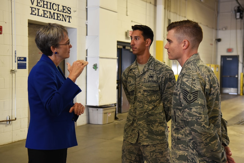 Secretary of the Air Force Heather Wilson speaks to Senior Airman Christopher Pilla, 90th Munitions Squadron nuclear weapons team member and Tech. Sgt. Evan McLelland, 90th Munitions Squadron nuclear weapons bay chief, during her tour Aug. 8, 2018, at F.E. Warren Air Force Base, Wyo. Pilla and McLelland were winners of the 90th Missile Wing's Innovation Fund and were discussing their idea of repaving the indoor track and banking the edges to help Airmen on base. Wilson visited the base to emphasize the importance of the wing's deterrence mission and to thank the Airmen for ensuring it is accomplished safely, securely and effectively every day. (U.S. Air Force photo by Senior Airman Breanna Carter)