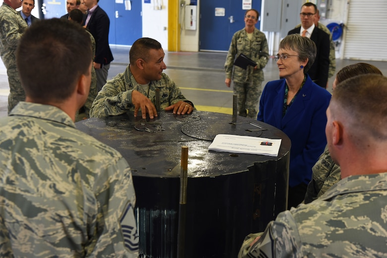 Col. Brian Rico, 90th Maintenance Group commander, discusses maintenance operations with Secretary of the Air Force Heather Wilson during her tour Aug. 8, 2018, at F.E. Warren Air Force Base, Wyo. The 90th MXG is charged with providing world-class maintenance for the 90th Missile Wing's Minuteman III Intercontinental Ballistic Missiles and the facilities that house them in support of U.S. Strategic Command requirements. Wilson visited the base to emphasize the importance of the wing's deterrence mission and to thank the Airmen for ensuring it is accomplished safely, securely and effectively every day. (U.S. Air Force photo by Senior Airman Breanna Carter)