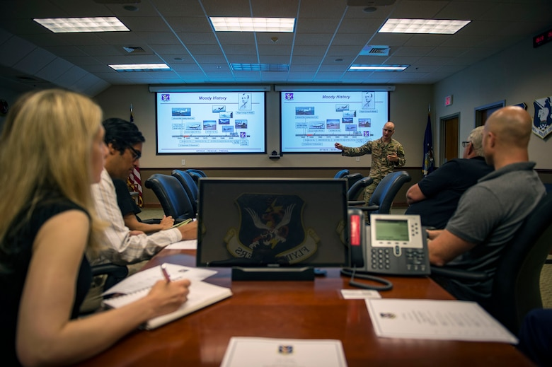 Capt. Bobby Theologis, 23d Wing executive officer, briefs Moody's mission capabilities to analysts from the RAND Corporation during a visit, Aug. 7, 2018, at Moody Air Force Base, Ga. RAND integrated with Moody's rescue, flying and maintenance professionals to examine firsthand Air Force operations. This familiarization helps RAND develop their analysis to ultimately present policy recommendations to Air Force decision makers. Since 1948, RAND has performed analysis for the U.S. Air Force. (U.S. Air Force photo by Senior Airman Greg Nash)