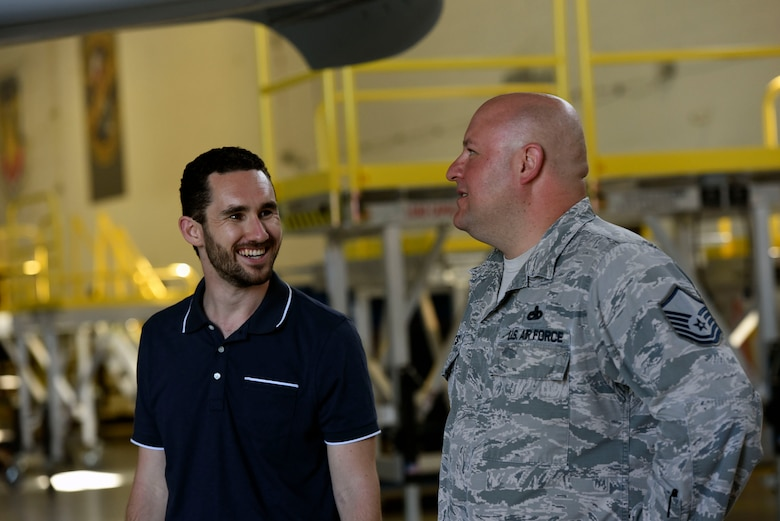 Master Sgt. Jason Butts, right, 23d Maintenance Squadron A-10C Thunderbolt II phase section chief, explains the functions of an A-10 to Colby Steiner, RAND Corporation associate physical scientist, during a visit, Aug. 8, 2018, at Moody Air Force Base, Ga. RAND integrated with Moody's rescue, flying and maintenance professionals to examine firsthand Air Force operations. This familiarization helps RAND develop their analysis to ultimately present policy recommendations to Air Force decision makers. Since 1948, RAND has performed analysis for the U.S. Air Force. (U.S. Air Force photo by Senior Airman Greg Nash)