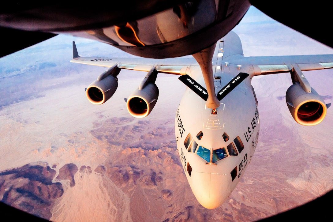 A 452nd Air Mobility Wing C-17 Globemaster III receives fuel from a 912th Aerial Refueling Squadron KC-135 Stratotanker during a refueling mission over Arizona, July 24, 2018. The 912th ARS is responsible for providing essential mission extending capabilities through refueling services. (U.S. Air Force photo by Staff Sgt. Jordan Castelan)