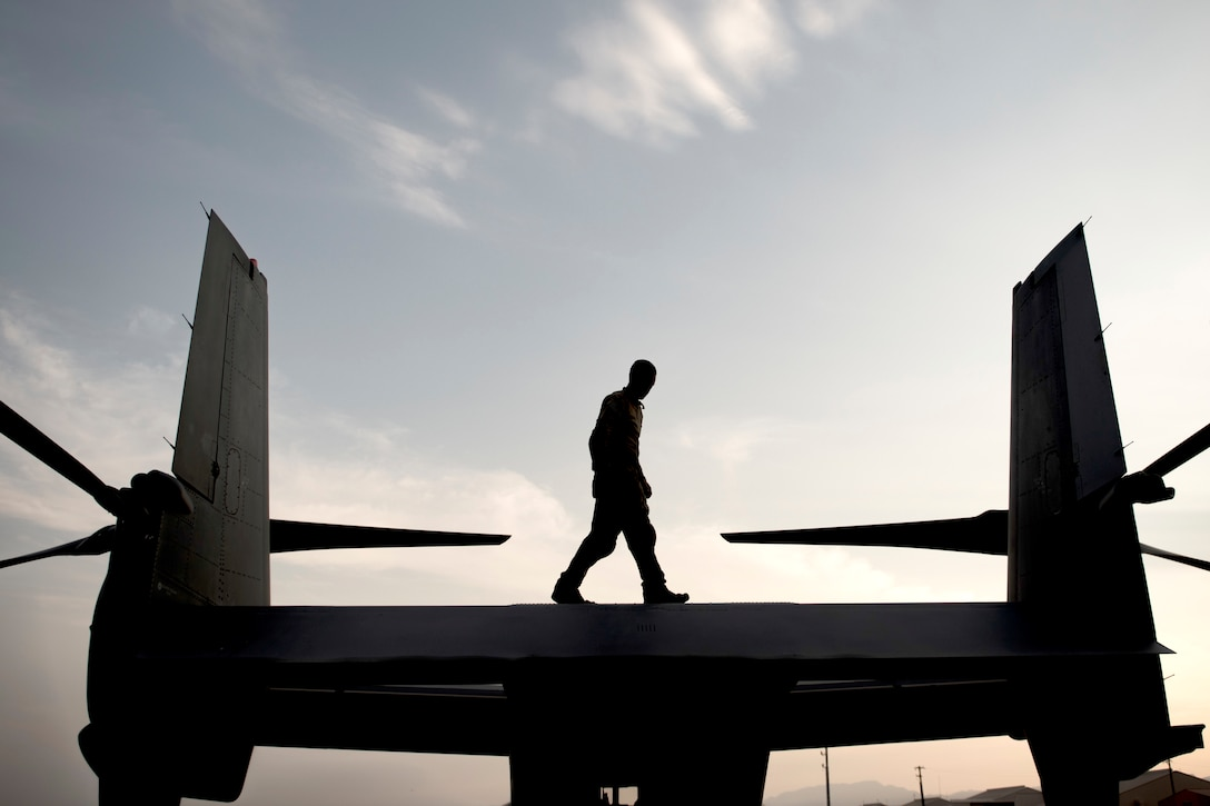 Tech. Sgt. Jared Rogness, a flight engineer with the 20th Special Operations Squadron at Cannon Air Force Base, N.M., walks atop a CV-22 Osprey tiltrotor aircraft during Red Flag 18-3 at Nellis AFB, Nev., July 31, 2018. The primary function of a CV-22 is to conduct long-range infiltration, exfiltration and resupply missions for special operations forces. (U.S Air Force photo by Airman 1st Class Andrew D. Sarver)
