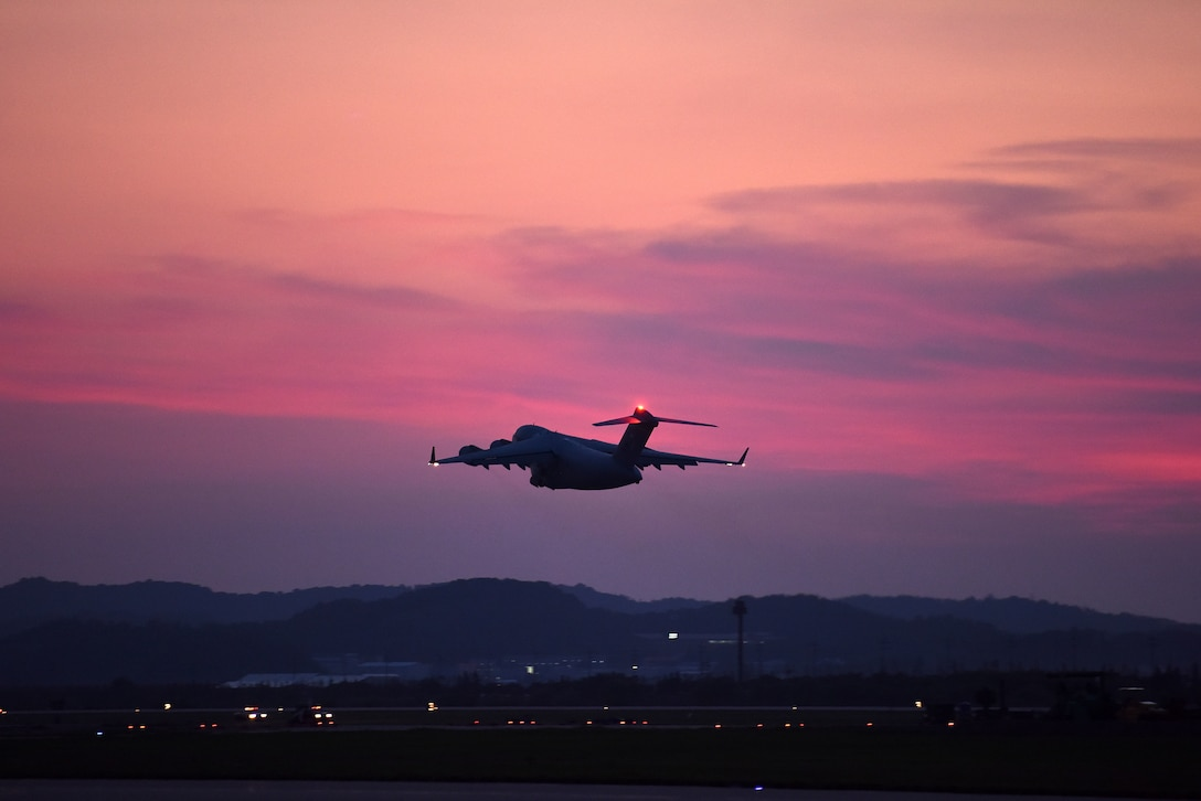 A C-17 Globemaster III, carrying dignified transfer cases containing fallen service members, takes off from Osan Air Base, South Korea, Aug. 1, 2018, en route to Joint Base Pearl Harbor-Hickam, Hawaii, where members of the Defense POW Accounting Agency will attempt to identify the remains. The remains of 55 cases were repatriated from North Korea. (U.S. Air Force photo by Senior Airman Kelsey Tucker)