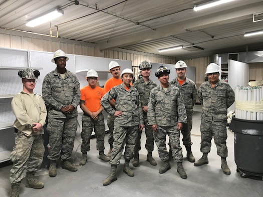 Airmen from the 49th Civil Engineer Squadron pose for a photo during the renovation of building 232. (Courtesy photo)