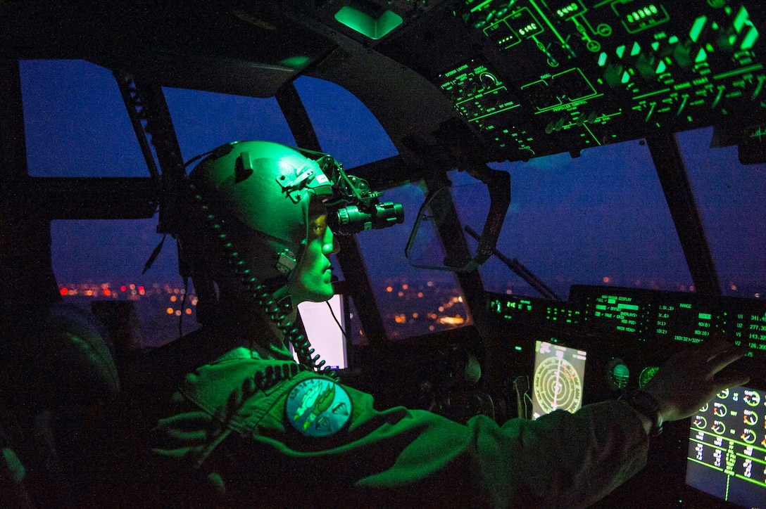 Capt. Leland Quinter, 37th Airlift Squadron C-130J Super Hercules pilot, wears night vision goggles during a training flight over Poland Aug. 2, 2018. C-130J pilots train to fly in multiple complex scenarios in various atmospheric conditions. (U.S. Air Force photo by Senior Airman Joshua Magbanua)