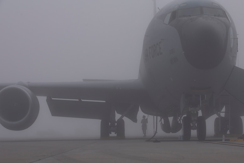 Airmen with the 121st Air Refueling Wing, work on a KC-135 Stratotanker in thick fog at Rickenbacker Air National Guard Base, Ohio, Aug. 3, 2018. Airmen stayed visible during the inclement weather by wearing their reflective belts. (U.S. Air National Guard photo by Airman 1st Class Tiffany A. Emery)