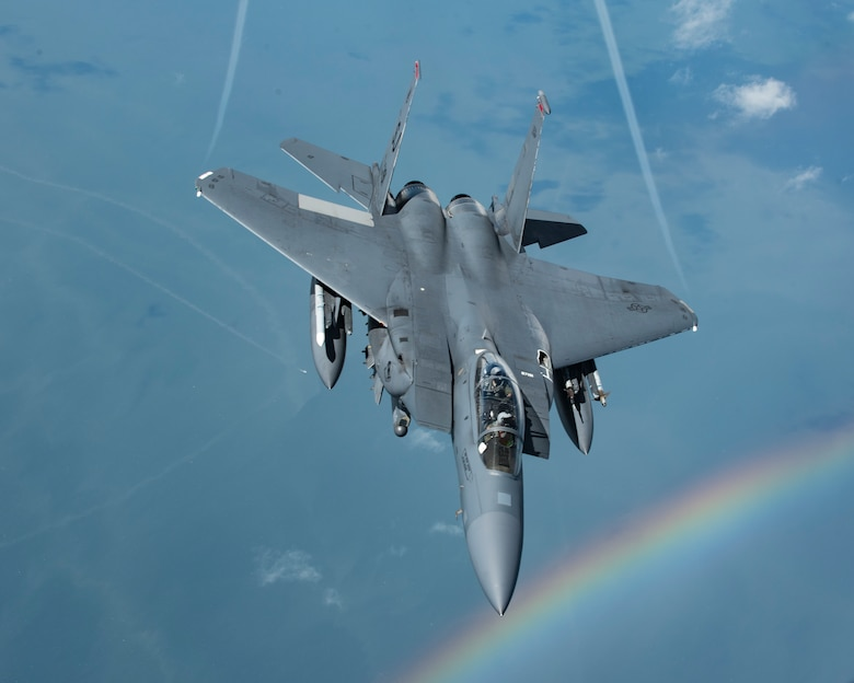 An F-15E Strike Eagle with the 4th Fighter Wing at Seymour Johnson Air Force Base, N.C., flies near a rainbow over the southeastern U.S. Aug. 8, 2018. The Strike Eagle had just been refueled by a KC-135 Stratotanker with the 121st Air Refueling Wing out of Ohio. (U.S. Air National Guard photo by Airman 1st Class Tiffany A. Emery)
