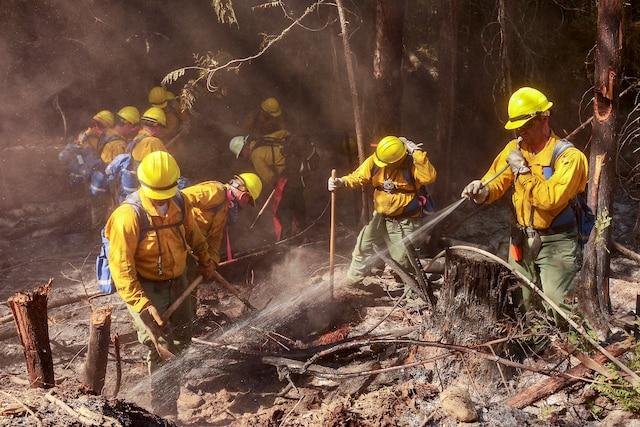 Air National Guard airmen fight a wildfire.