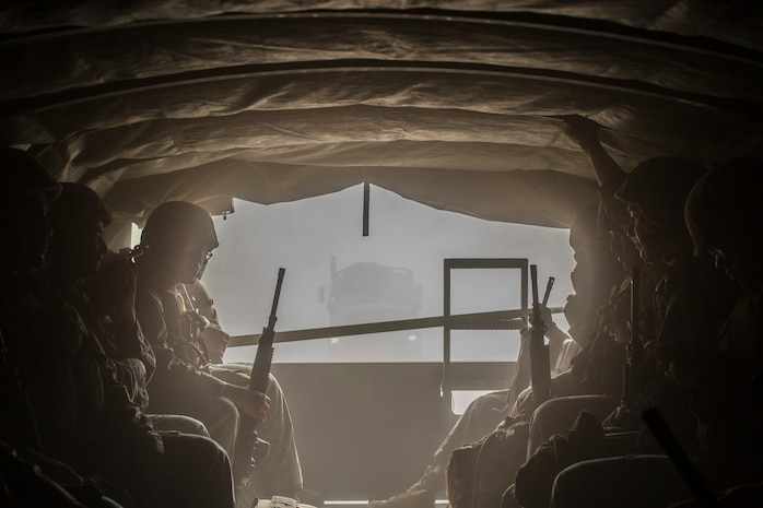 U.S. Marines with Marine Wing Support Squadron 171 ride in a 7-ton truck during Exercise Eagle Wrath 18 at Combined Arms Training Center Camp Fuji, Japan, July 18, 2018. Eagle Wrath 18 is an annual training exercise designed to increase squadron proficiency in a forward operating environment, test forward command and control structure, and practice for real-world contingency missions.