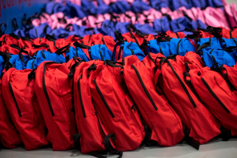 Backpacks filled with back to school supplies line the floor of the Youth Center at Mountain Home Air Force Base, Idaho, Aug. 4, 2018. 200 backpacks were packed with supplies and handed out to school age military children.