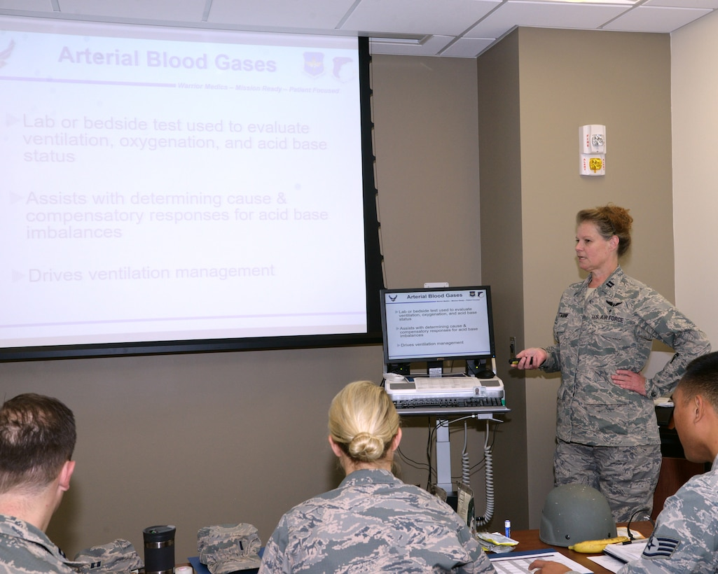 Capt. Laura Wittman, an Individual Mobilization Augmentee who is currently serving as a special projects officer in the 59th Medical Wing's education and training department, conducts training for wing personnel on Aug. 9, 2018. IMAs are Air Force Reservists assigned to one of more than 50 active-component units and government agencies around the world. (U.S. Air Force photo by Daniel J. Calderón)