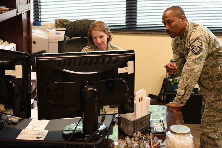 U.S. Air Force Senior Master Sgt. Brandy Hill, left, and Master Sgt. Jamell Camper, right, 20th Force Support Squadron career assistance advisors (CAA), review records at Shaw Air Force Base, S.C., Aug. 3, 2018.