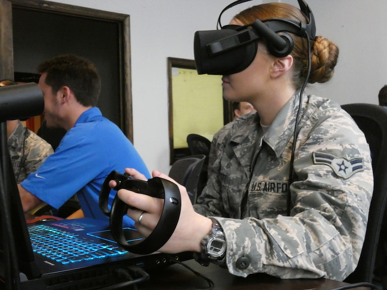 Airman 1st Class Lysle, 36th Intelligence Squadron, completes a virtual reality demo at a collaborative workspace in downtown Norfolk, Virginia.