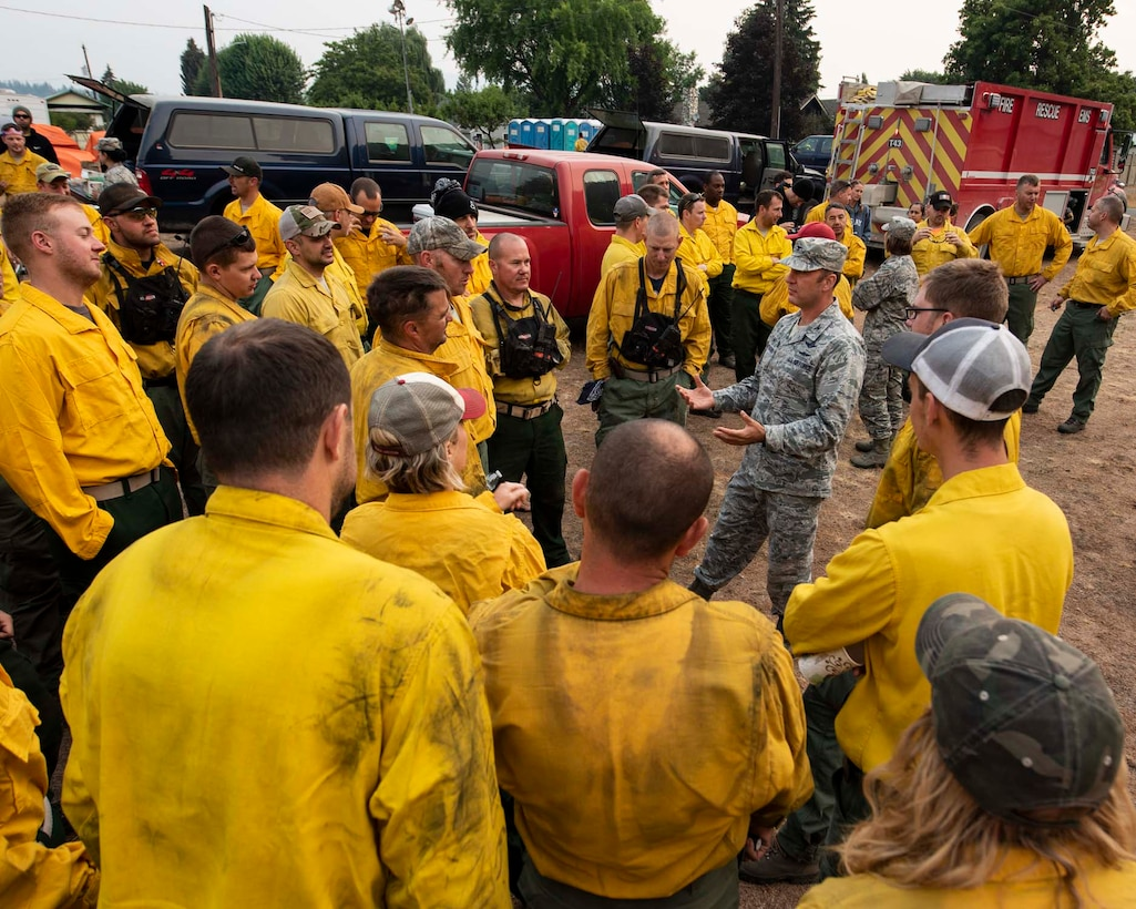 Col. Johan Deutscher, commander of the 141st Air Refueling Wing, greets guardsmen from the 141st who mobilized to Northport, Wash. to support firefighting efforts for the Sheep Creek fire August 8, 2018. Nearly 60 Guardsmen from the 141st ARW were mobilized to help support firefighting efforts throughout the region. (U.S. Air National Guard photo by Staff Sgt. Rose M. Lust)