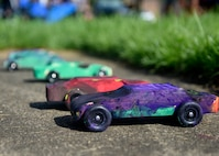 Painted derby cars are left in the sun to dry during the 7th Annual Exceptional Family Member Program Summer Camp Experience at Joint Base Andrews, Md., Aug. 9, 2018. Camp attendees decorated and raced the cars as part of the weeklong STEM-based camp. (U.S. Air Force photo by Senior Airman Abby L. Richardson)