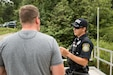 Fort McCoy police officer Dustin J. Dunse directs two civilians to the lakes their fishing licenses permit them to use at Fort McCoy, Wisconsin, Aug. 7, 2018. He supports the Soldiers visiting Fort McCoy by ensuring they are able to train in a safe environment. (U.S. Army Reserve photo by Staff Sgt. Christopher Freude)