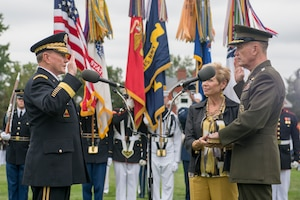 Current chairman of the Joint Chiefs of Staff Marine Corps Gen. Joe Dunford, right, takes the oath of office from his predecessor, Army Gen. Martin E. Dempsey during a change of office and retirement ceremony at Joint Base Myer-Henderson Hall in Arlington, Va., Sept. 25, 2015.