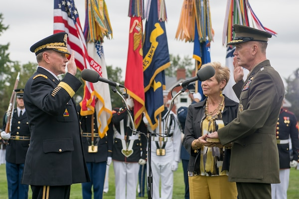 Current chairman of the Joint Chiefs of Staff Marine Corps Gen. Joe Dunford, right, takes the oath of office from his predecessor, Army Gen. Martin E. Dempsey during a change of office and retirement ceremony at Joint Base Myer-Henderson Hall in Arlington, Va., Sept. 25, 2015. DoD photo by D. Myles Cullen