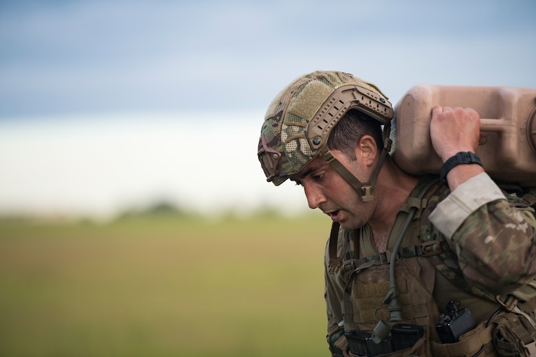 1st Lt. Andrew Janosick, 20th Air Support Operations Squadron (ASOS) joint terminal attack controller (JTAC), executes a ruck march during Draco Spear, Aug. 3, 2018, at Moody Air Force Base, Ga. Draco Spear is a revival of the mid-2000s joint-training event Dragon Challenge that tested the top JTACs from various air support operations squadrons both mentally and physically. (U.S. Air Force photo by Senior Airman Janiqua P. Robinson)