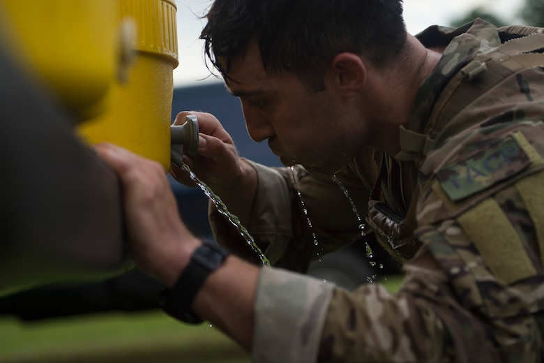 1st Lt. Andrew Janosick, 20th Air Support Operations Squadron (ASOS) joint terminal attack controller (JTAC), drinks water after a ruck march during Draco Spear, Aug. 3, 2018, at Moody Air Force Base, Ga. Draco Spear is a revival of the mid-2000s joint-training event Dragon Challenge that tested the top JTACs from various air support operations squadrons both mentally and physically. (U.S. Air Force photo by Senior Airman Janiqua P. Robinson)