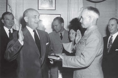 Defense Secretary Louis A. Johnson swears in General of the Army Omar N. Bradley as the nation's first chairman of the Joint Chiefs of Staff, Aug. 16, 1949.