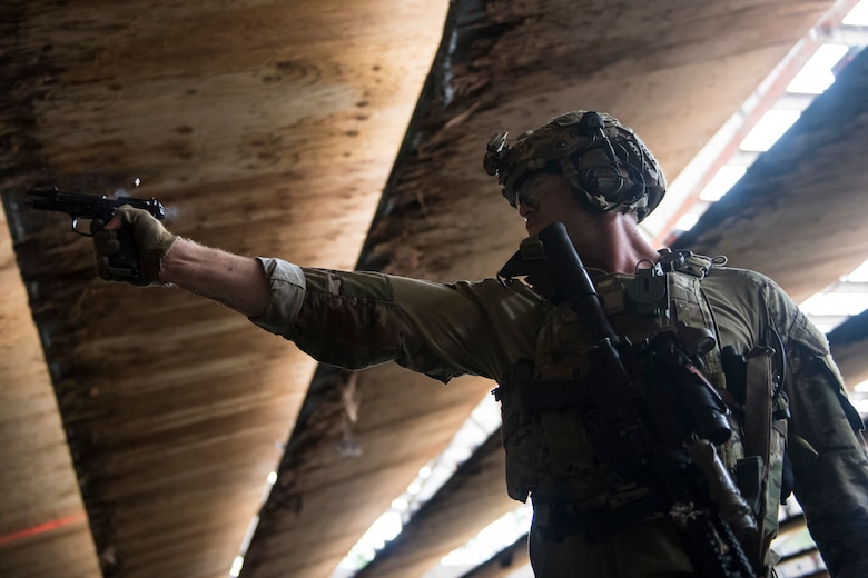 Tech. Sgt. Ryan Shipman, 19th Air Support Operations Squadron (ASOS) joint terminal attack controller (JTAC), fires an M9 Beretta pistol during Draco Spear, Aug. 3, 2018, at Moody Air Force Base, Ga. Draco Spear is a revival of the mid-2000s joint-training event Dragon Challenge that tested the top JTACs from various air support operations squadrons both mentally and physically. (U.S. Air Force photo by Senior Airman Janiqua P. Robinson)