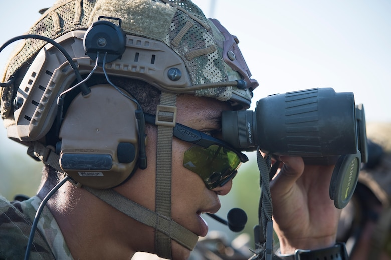 Senior Airman Tyler Hill, 20th Air Support Operations Squadron (ASOS) joint terminal attack controller (JTAC), uses binoculars to locate reference points during Draco Spear, Aug. 6, 2018, at Moody Air Force Base, Ga. Draco Spear is a revival of the mid-2000s joint-training event Dragon Challenge that tested the top JTACs from various air support operations squadrons both mentally and physically. (U.S. Air Force photo by Senior Airman Janiqua P. Robinson)