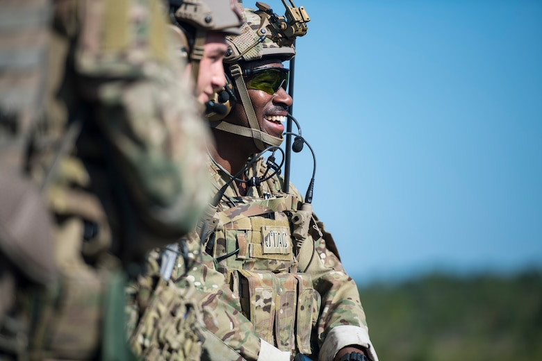 Staff Sgt. David Brown, 15th Air Support Operations Squadron (ASOS) joint terminal attack controller (JTAC), laughs after finishing a speed drill during Draco Spear, Aug. 6, 2018, at Moody Air Force Base, Ga. Draco Spear is a revival of the mid-2000s joint-training event Dragon Challenge that tested the top JTACs from various air support operations squadrons both mentally and physically. (U.S. Air Force photo by Senior Airman Janiqua P. Robinson)
