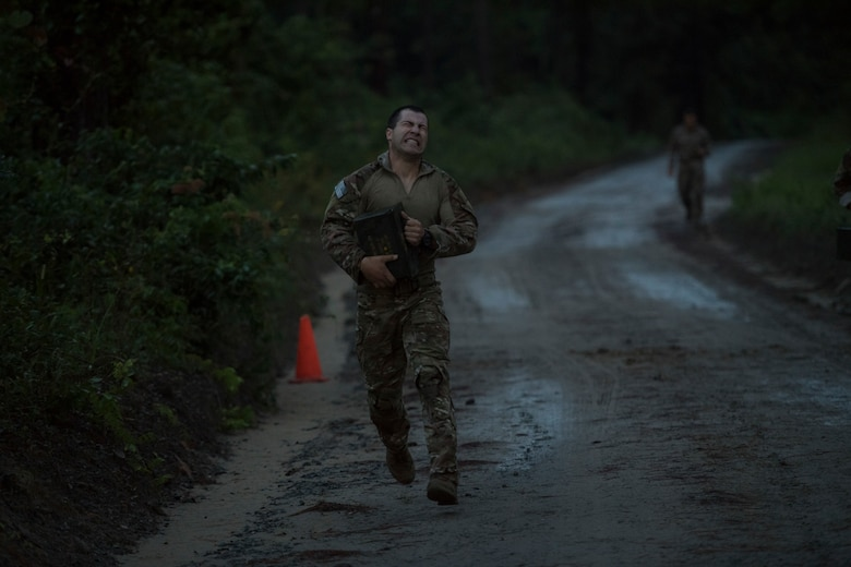 Staff Sgt. Ryan Holst, 19th Air Support Operations Squadron (ASOS) joint terminal attack controller, runs his final sprint during Draco Spear, Aug. 3, 2018, at Moody Air Force Base, Ga. Draco Spear is a revival of the mid-2000s joint-training event Dragon Challenge that tested the top JTACs from various air support operations squadrons both mentally and physically. (U.S. Air Force photo by Senior Airman Janiqua P. Robinson)
