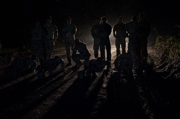 Joint terminal attack controllers from the 18th Air Support Operations Group perform push-ups before sunrise during Draco Spear, Aug. 3, 2018, at Moody Air Force Base, Ga.Draco Spear is a revival of the mid-2000s joint-training event Dragon Challenge that tested the top JTACs from various air support operations squadrons both mentally and physically. (U.S. Air Force photo by Senior Airman Janiqua P. Robinson)