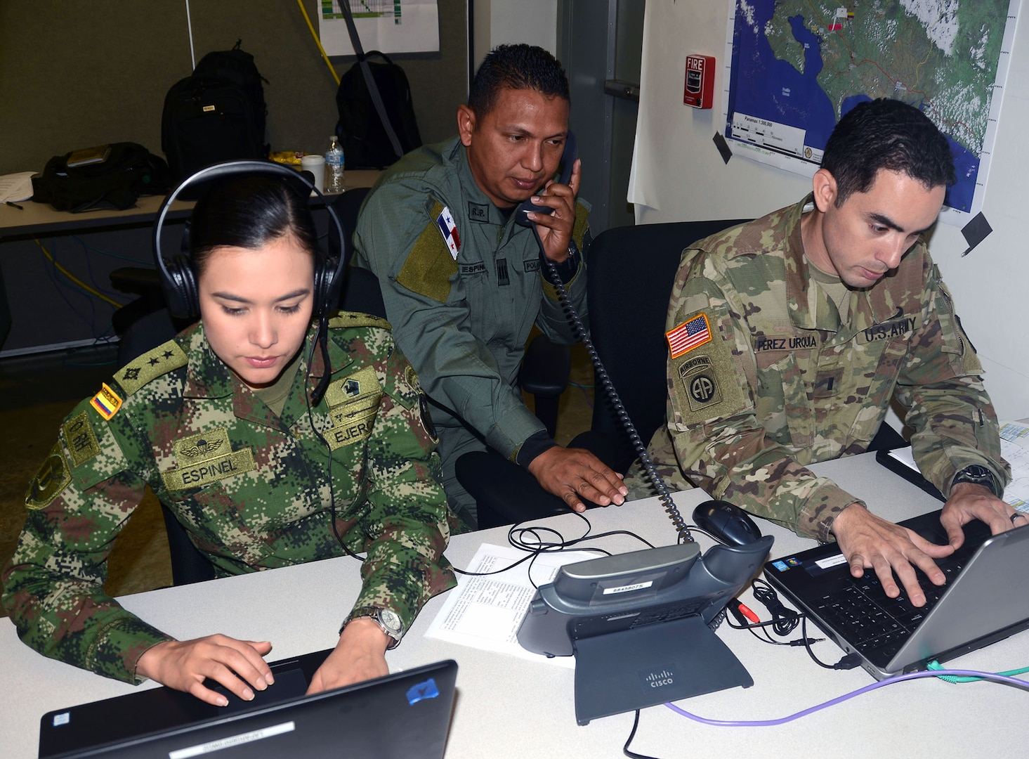 Soldiers from Colombia and the U.S. and an officer from the Panamanian National Police, work in the communications cell of the Combined Forces Land Component Command operations center at the Mission Training Complex at Joint Base San Antonio-Fort Sam Houston Aug. 8.